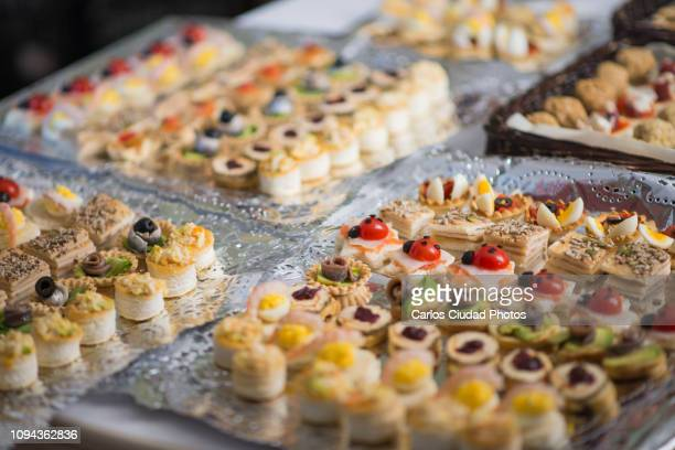 trays full of canapes on table for christmas dinner, madrid, spain - christmas beetle stock pictures, royalty-free photos & images