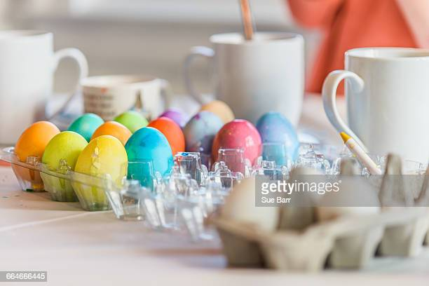 Trays of dyed Easter eggs on table