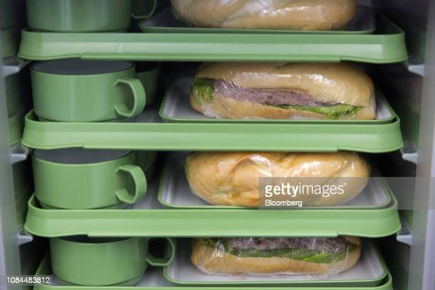 Trays of inflight meals sit in a cart on board an Airbus SE A321 Neo aircraft operated by FLC Group JSC's Bamboo Airways on the first day of the...