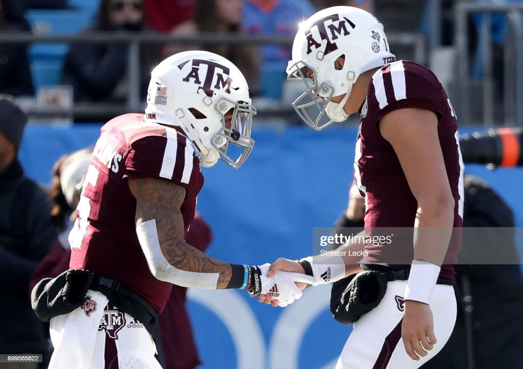 Trayveon Williams #5 celebrates with teammate Nick Starkel #17 of the Texas A&M Aggies after running for a touchdown against the Wake Forest Demon Deacons during the Belk Bowl at Bank of America Stadium on December 29, 2017 in Charlotte, North Carolina.