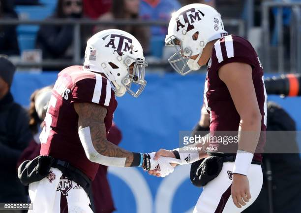 Trayveon Williams celebrates with teammate Nick Starkel of the Texas AM Aggies after running for a touchdown against the Wake Forest Demon Deacons...