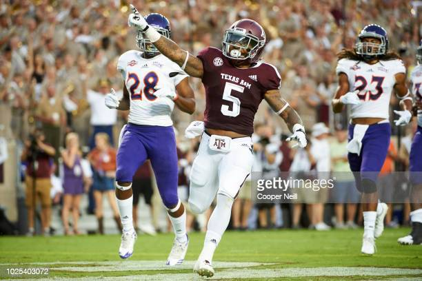 Trayveon Williams of the Texas AM Aggies celebrates after scoring on a 73 yard touchdown run against the Northwestern State Demons during the first...