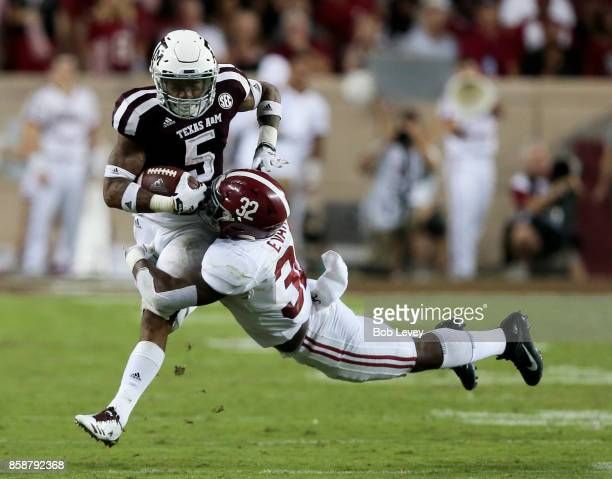 Trayveon Williams of the Texas AM Aggies is tackled by Rashaan Evans of the Alabama Crimson Tide in the second quarter at Kyle Field on October 7...