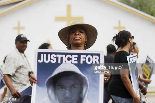Trayvon Martin supporter displays her sign during a march through the historically African American community of Goldsboro on their way to a rally in...