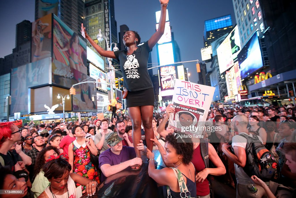 Trayvon Martin supporters rally in Times Square while blocking traffic after marching from a rally for Martin in Union Square in Manhattan on July 14, 2013 in New York City. George Zimmerman was acquitted of all charges in the shooting death of Martin July 13 and many protesters questioned the verdict.