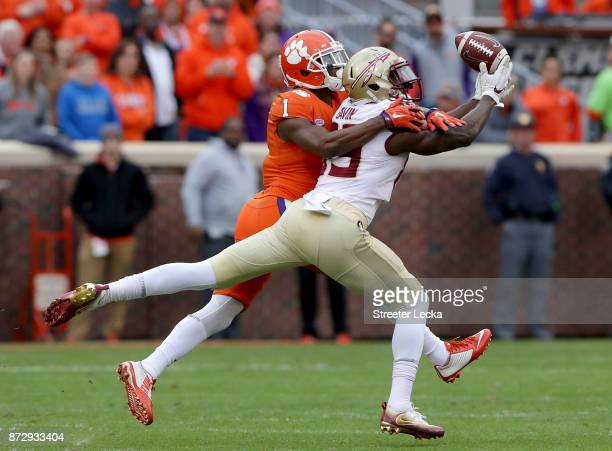 Trayvon Mullen of the Clemson Tigers breaks up a pass to Keith Gavin of the Florida State Seminoles during their game at Memorial Stadium on November...