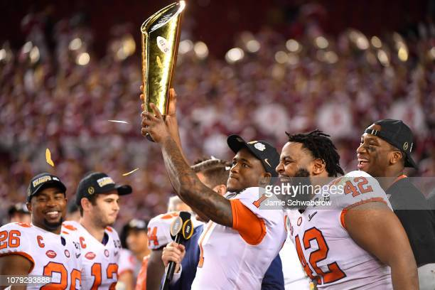 Trayvon Mullen of the Clemson Tigers receives the trophy after defeating the Alabama Crimson Tide during the College Football Playoff National...