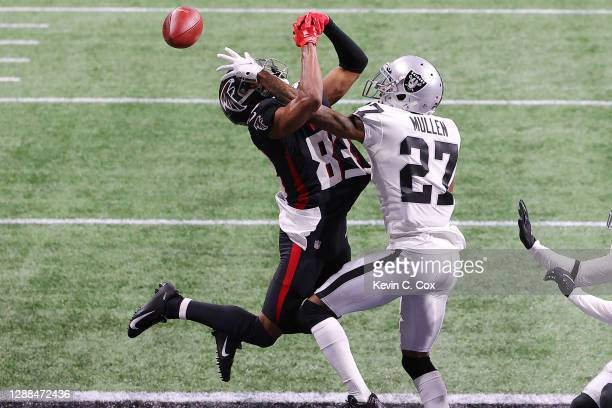Trayvon Mullen of the Las Vegas Raiders breaks up a pass in the end zone intended for Russell Gage of the Atlanta Falcons during their NFL game at...