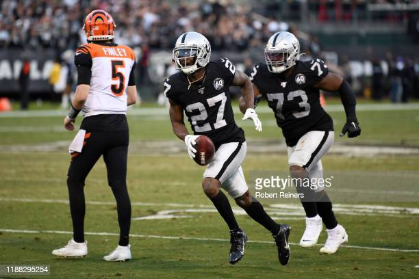 Trayvon Mullen of the Oakland Raiders celebrates his interception of Ryan Finley of the Cincinnati Bengals in the final moments of their NFL game at...