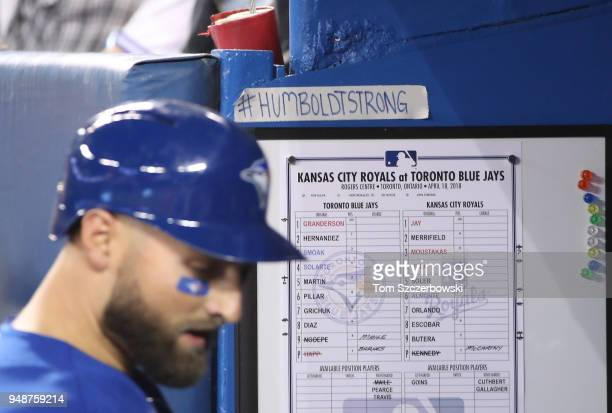 A trbute for the fallen members of the Humboldt Broncos hockey team appears in the Blue Jays dugout as Kevin Pillar of the Toronto Blue Jays walks...