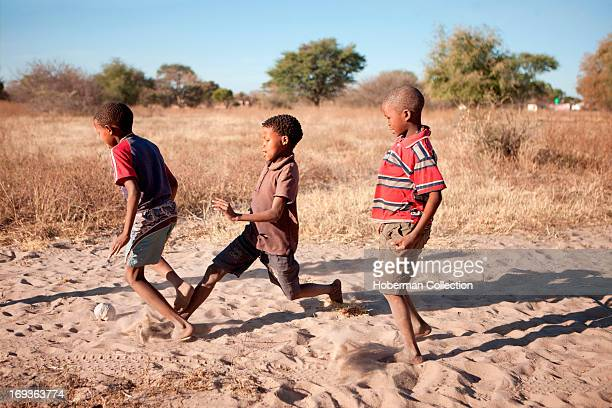 Trditional bushmen boys playing in Namiba