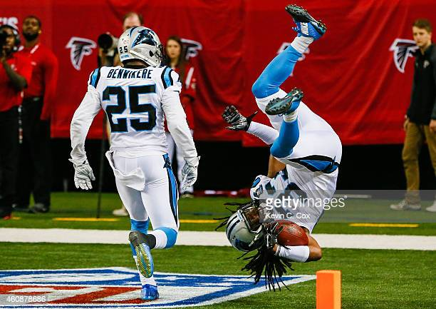 Tre Boston of the Carolina Panthers celebrates an interception return for a touchdown in the second half against the Atlanta Falcons at the Georgia...
