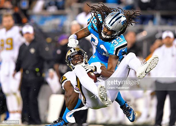 Tre Boston of the Carolina Panthers defends a pass to Brandon Coleman of the New Orleans Saints in the 4th quarter during the game at Bank of America...
