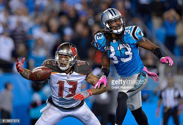 Tre Boston of the Carolina Panthers defends a pass to Mike Evans of the Tampa Bay Buccaneers during the game at Bank of America Stadium on October 10...