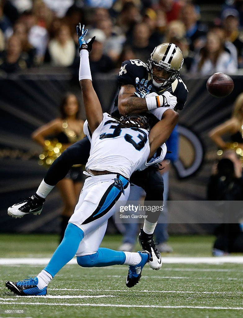 Tre Boston #33 of the Carolina Panthers is tackled by Joseph Morgan #13 of the New Orleans Saints during the second quarter at Mercedes-Benz Superdome on December 7, 2014 in New Orleans, Louisiana.