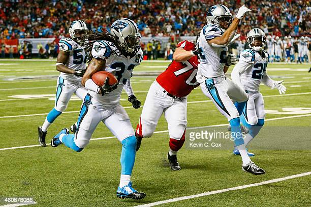 Tre Boston of the Carolina Panthers returns an interception for a touchdown in the second half against the Atlanta Falcons at the Georgia Dome on...