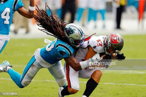 Tre Boston of the Carolina Panthers tackles Justin Watson of the Tampa Bay Buccaneers during the first half at Raymond James Stadium on September 20,...
