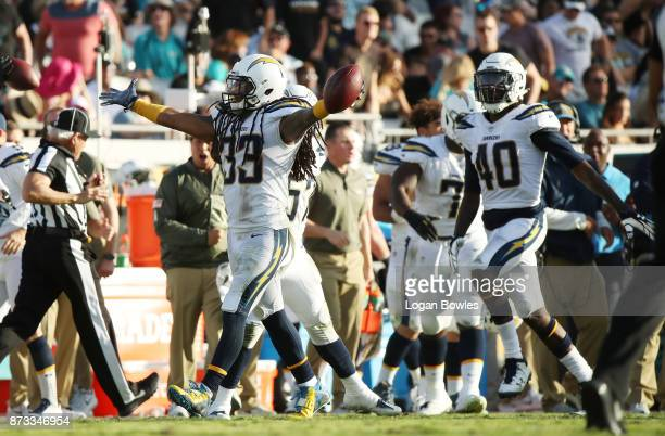 Tre Boston of the Los Angeles Chargers celebrates after an interception in the second half of their game against the Jacksonville Jaguars at EverBank...