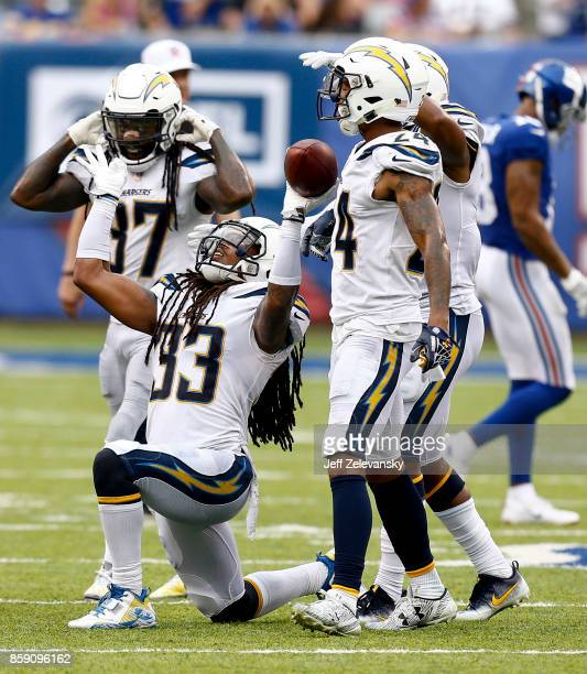 Tre Boston of the Los Angeles Chargers celebrates his interception during their game against the New York Giants at MetLife Stadium on October 8 2017...