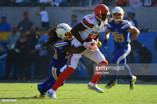 Tre Boston of the Los Angeles Chargers tackles Josh Gordon of the Cleveland Browns during the first quarter of the game at StubHub Center on December...