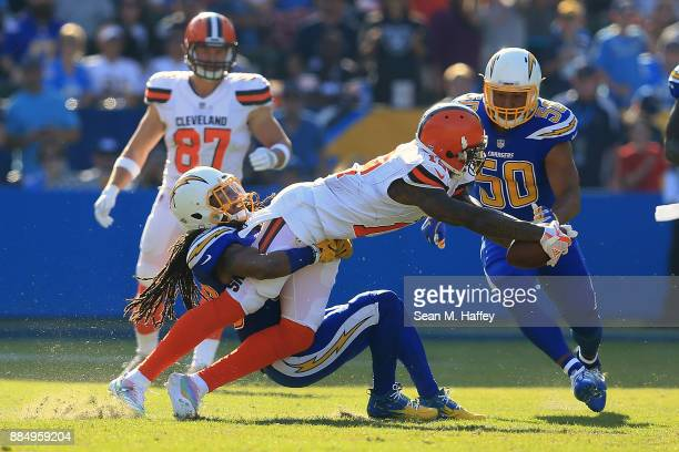Tre Boston of the Los Angeles Chargers tackles Josh Gordon of the Cleveland Browns during the game at StubHub Center on December 3 2017 in Carson...