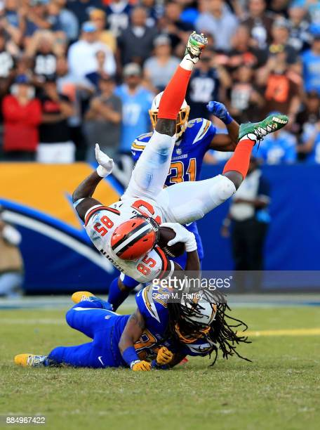 Tre Boston of the Los Angeles Chargers upends David Njoku of the Cleveland Browns on a short pass play during the second half of a game at StubHub...