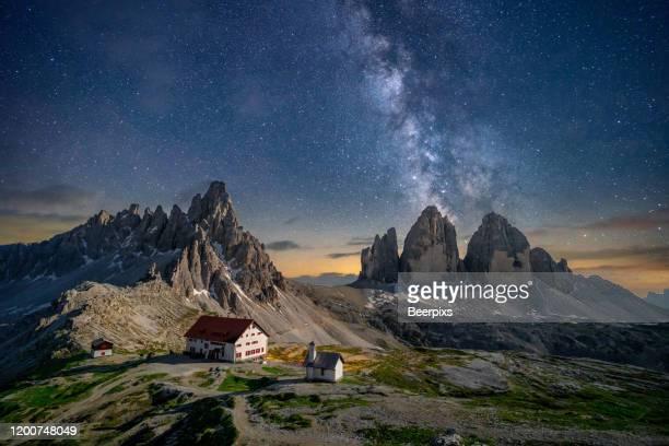tre cime di lavaredo at night with a milky way on background. dolomites, italy. - トレチーメディラバレード ストックフォトと画像