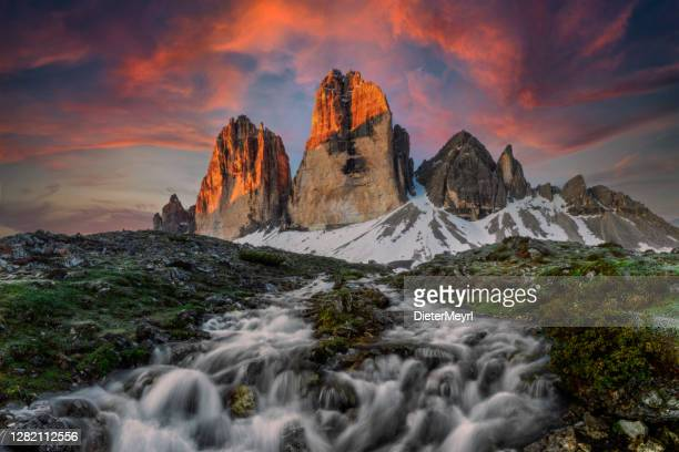 tre cime sunrise with mountain stream, long exposure - three objects stock pictures, royalty-free photos & images