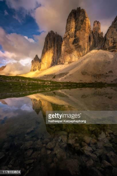 tre cime with reflection - トレチーメディラバレード ストックフォトと画像
