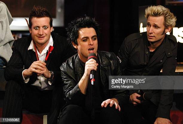 Tre Cool Billie Joe Armstrong and Mike Dirnt of Green Day