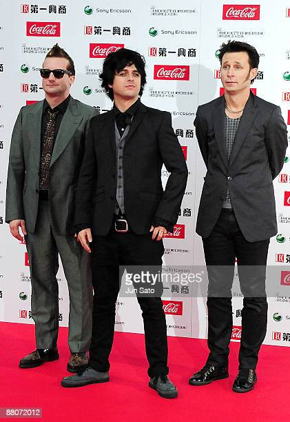 Tre Cool Billie Joe Armstrong and Mike Dirnt of Green Day pose on the red carpet during the MTV Video Music Awards Japan 2009 at Saitama Super Arena...