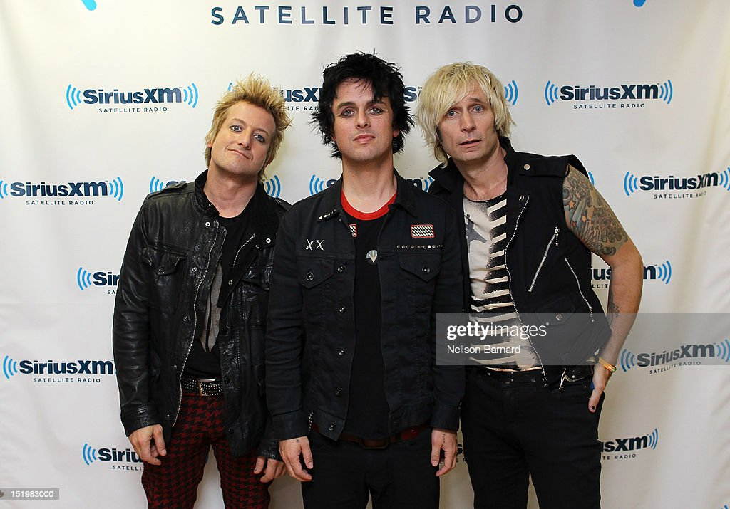 Tre Cool, Billie Joe Armstrong and Mike Dirnt of Green Day visit the SiriusXM Studios on September 14, 2012 in New York City.