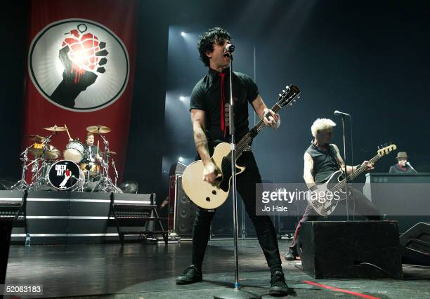 Tre Cool Billie Joe Armstrong and Mike Dirnt of the Californian band Green Day perform at the Carling Academy Brixton on January 25 2005 in London...