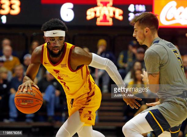 Tre Jackson of the Iowa State Cyclones handles the ball against Jordan McCabe of the West Virginia Mountaineers at the WVU Coliseum on February 5...