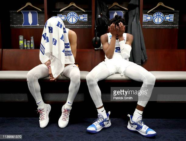 Tre Jones and Cam Reddish of the Duke Blue Devils react in the locker room after their teams 6867 loss to the Michigan State Spartans in the East...