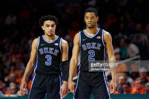 Tre Jones and Cassius Stanley of the Duke Blue Devils look on against the Miami Hurricanes during the second half at the Watsco Center on January 04...