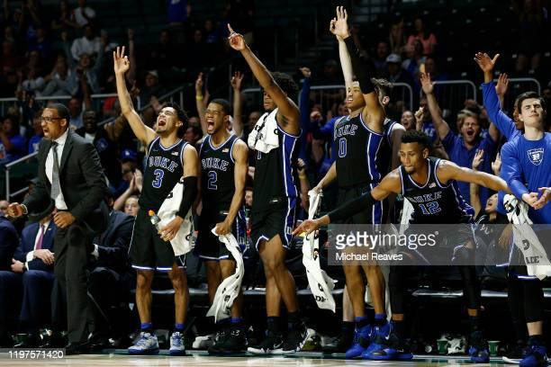 Tre Jones Cassius Stanley Vernon Carey Jr #1 Wendell Moore Jr #0 and Javin DeLaurier of the Duke Blue Devils react after a basket against the Miami...