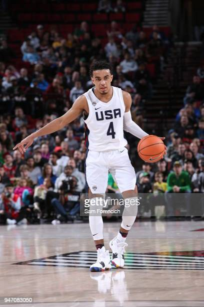 Tre Jones of Team USA dribbles the ball against Team World during the Nike Hoop Summit on April 13 2018 at the MODA Center Arena in Portland Oregon...