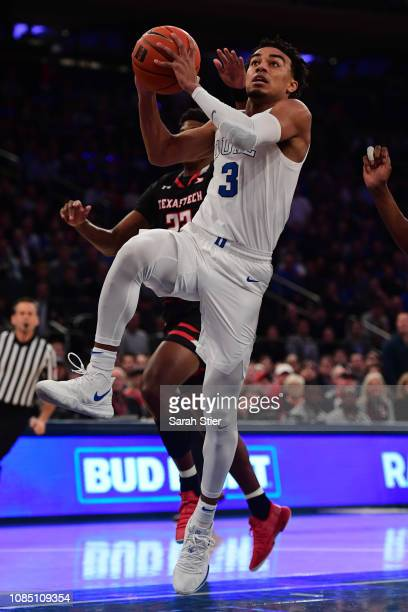 Tre Jones of the Duke Blue Devils attempts a basket during the first half of the game against Texas Tech Red Raiders during the Ameritas Insurance...