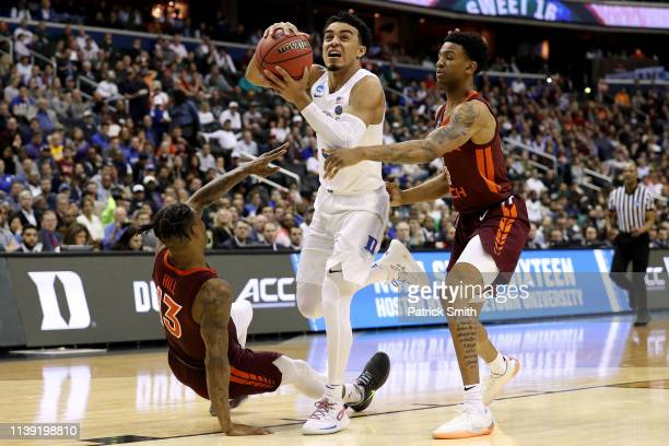 Tre Jones of the Duke Blue Devils drives to the basket against Ahmed Hill and Nickeil AlexanderWalker of the Virginia Tech Hokies during the second...