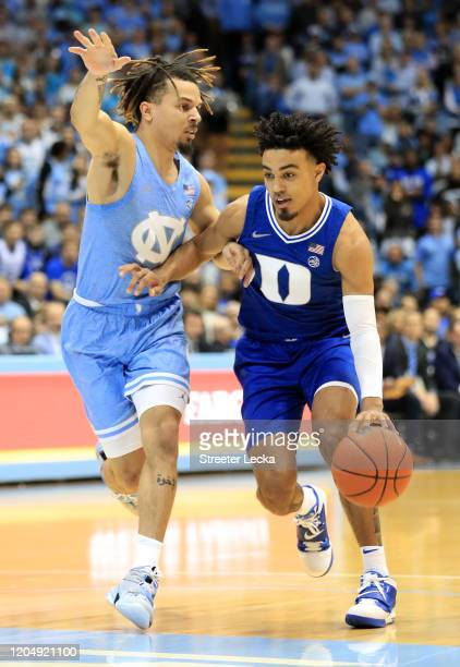 Tre Jones of the Duke Blue Devils drives to the basket against Cole Anthony of the North Carolina Tar Heels during their game at Dean Smith Center on...