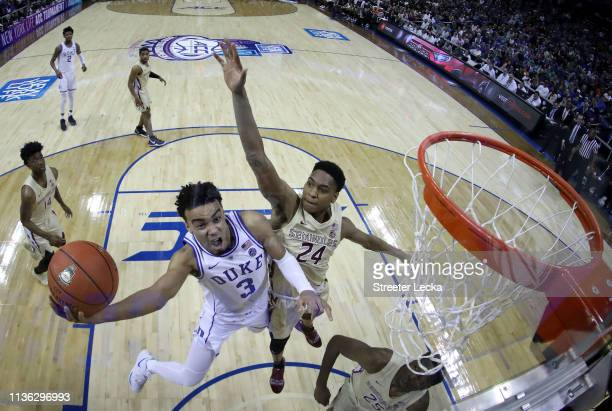 Tre Jones of the Duke Blue Devils drives to the basket against Devin Vassell of the Florida State Seminoles during the championship game of the 2019...