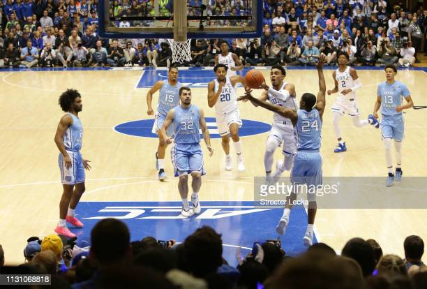 Tre Jones of the Duke Blue Devils drives to the basket against Kenny Williams of the North Carolina Tar Heels during their game at Cameron Indoor...