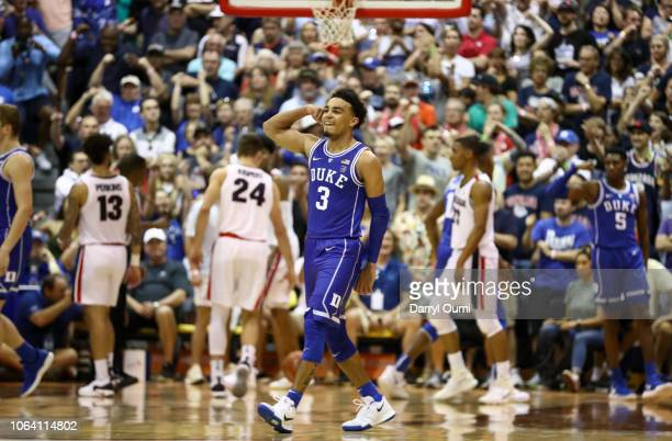 Tre Jones of the Duke Blue Devils flexes his biceps after a hard fough basket during the second half of the game against the Gonzaga Bulldogs at the...