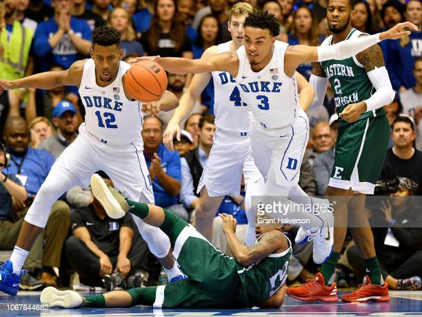 Tre Jones of the Duke Blue Devils hurdles Kevin McAdoo of the Eastern Michigan Eagles to track down a loose ball during the first half of their game...