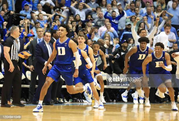 Tre Jones of the Duke Blue Devils reacts after making a shot at the end of regulation to send the game to overtime against the North Carolina Tar...