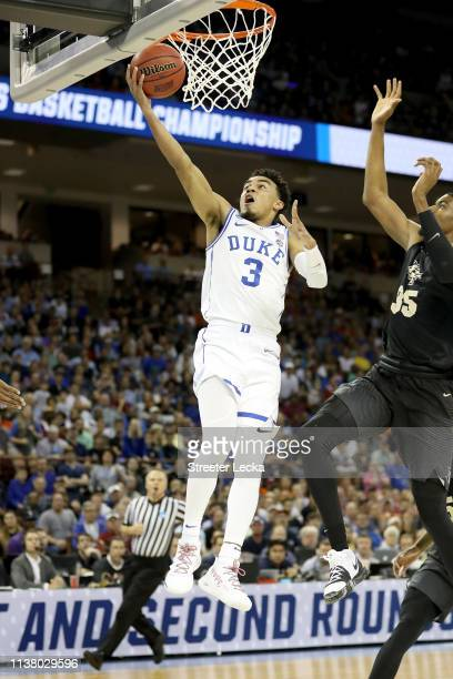 Tre Jones of the Duke Blue Devils shoots the ball against Collin Smith of the UCF Knights in the second round game of the 2019 NCAA Men's Basketball...