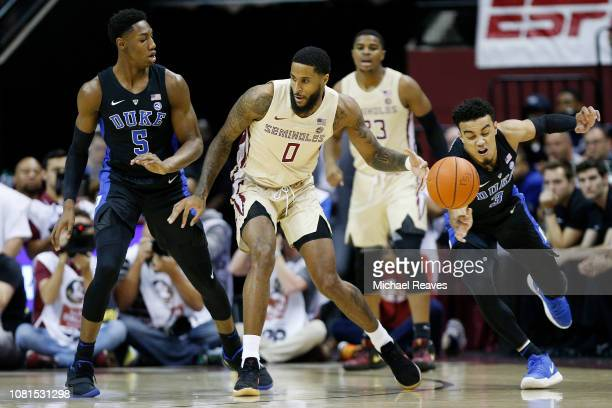 Tre Jones of the Duke Blue Devils steals the ball from Phil Cofer of the Florida State Seminoles during the first half at Donald L Tucker Center on...