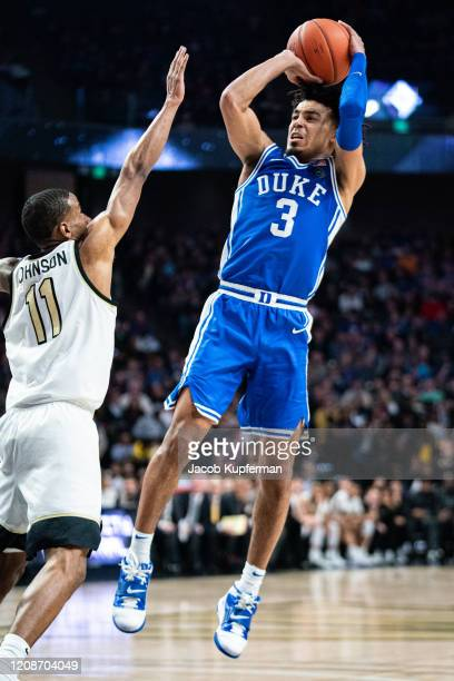 Tre Jones of the Duke Blue Devils takes a shot over Torry Johnson of the Wake Forest Demon Deacons during the second half during their game at LJVM...