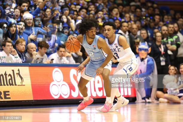 Tre Jones of the Duke Blue Devils tries to stop Coby White of the North Carolina Tar Heels during their game at Cameron Indoor Stadium on February 20...